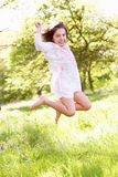 Young Girl Jumping In Summer Field Royalty Free Stock Images