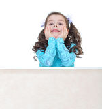 Young girl jumping on a trampoline. Royalty Free Stock Photography