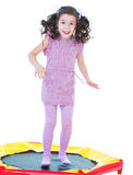 Young girl jumping on a trampoline. Royalty Free Stock Photos