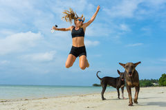 The young girl jumps on the beach of the island Samui. Royalty Free Stock Photo