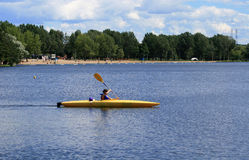 Young Girl Kayaking at Beach Royalty Free Stock Photo