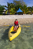 Young girl kayaking in Vanuatu Stock Photo