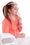 Young girl keeping inhale mask Stock Photo
