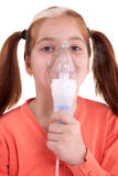 Young girl keeping inhale mask Royalty Free Stock Photo