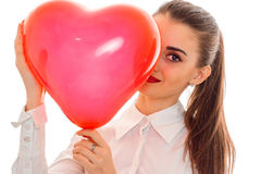 Young girl keeps near big balloon sweetheart close-up Stock Images