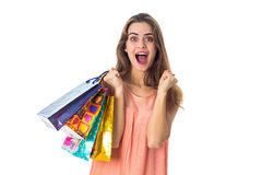Young girl keeps packages in hand and rejoices. Closeup Stock Photography
