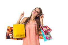 Young girl keeps on their hands different color packages from stores isolated  white background Stock Photo