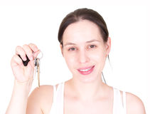 Young girl with the key, isolated over white. Stock Photography