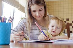Young girl kid drawing with her sister royalty free stock photography