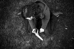 Young girl after killing. Young sad girl in the floor after killing Stock Photo