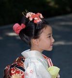 Young girl in kimono, Tokyo, Japan. A young girl wears kimono in Meiji Shrine, Tokyo Royalty Free Stock Image