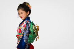 Young Girl in Kimono on White Royalty Free Stock Photography