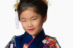 Young Girl in Kimono on White Royalty Free Stock Image