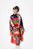 Young Girl in Kimono on White Stock Image