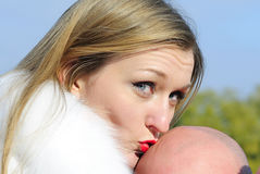 The young girl kisses a bald head of the man Royalty Free Stock Images