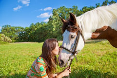 A young girl kisses horse Royalty Free Stock Photography