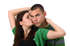 Young girl kisses and hugs her boyfriend isolated stock images