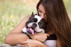 Young Girl Kissing Her Dog Stock Photos