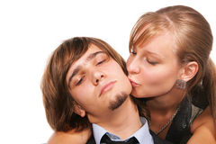 Young girl kissing young man Stock Photos