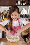 Young girl in the kitchen Stock Photos