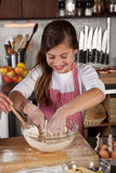 Young girl in the kitchen Royalty Free Stock Photo
