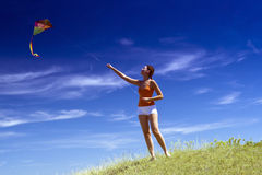 Young girl kite fly. Beautiful young girl kite fly royalty free stock photo