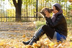 Young girl with a kitten outdoors Royalty Free Stock Photos