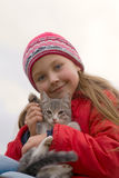 Young girl with kitty. Young girl keeps gray a kitty on hand Royalty Free Stock Photography