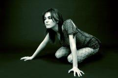 Young Girl Kneeling on Floor Royalty Free Stock Image