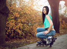 Young girl kneeling on roller skates. Stock Photography
