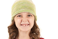 Young girl in knit hat missing one tooth Stock Photo