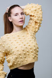 Young girl in knitted sweater royalty free stock image