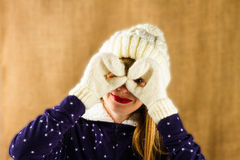 Young girl in a knitted white cap and mittens Stock Photo