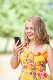 Girl with smartphone outdoors stock images