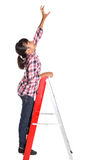 Young Girl On A Ladder I Royalty Free Stock Image