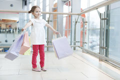 Young girl laden with paper shopping bags Royalty Free Stock Photography