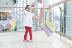 Young girl laden with paper shopping bags Royalty Free Stock Photo