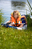 Young girl at a lake Stock Photo
