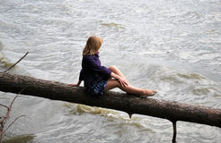 Young girl on lake Royalty Free Stock Images