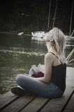 Young girl by lake Stock Photography