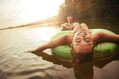 Young girl in lake on innertube Royalty Free Stock Images