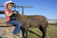 Young Girl and Lamb Royalty Free Stock Photo