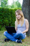 Young girl with lap top Royalty Free Stock Photo