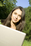 Young girl with a Laptop Stock Photos