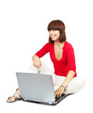 Young girl with laptop Royalty Free Stock Photography