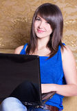 Young girl with laptop. Indoor royalty free stock photography
