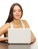 Young girl with laptop Stock Images