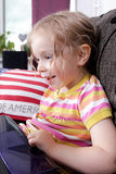 Young girl with laptop Stock Image