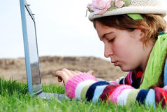 Young girl and laptop Stock Image
