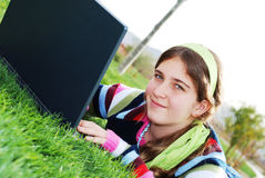 Young girl and laptop Royalty Free Stock Photos